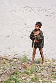 KALANKI, NEPAL - APRIL 2: Portrait of unidentified Nepalese herder boy with a rod on April 2, 2009 i