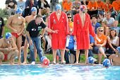 KAPOSVAR, HUNGARY - SEPTEMBER 15: Honved players listening to trainer iat a Hungarian championship water-polo game between Kaposvar (white) and Honved (blue) on September 15, 2013 in Kaposvar, Hungary