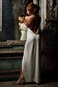 Beautiful Woman In White Dress With Naked Back.