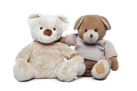picture of stuffed animals  - Two Teddy bears hugging each other over white background - JPG