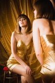 Charming Woman In Short Golden Dress