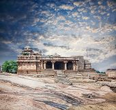 pic of vijayanagara  - Ancient ruins of Vijayanagara Empire at blue sky in Hampi Karnataka India - JPG