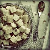 Heap Of Brown Sugar Cubes On Metal Plate On Wooden Tray