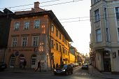 KRAKOW, POLAND - MAR 9, 2014: One of the streets in historical center of Krakow. This year the city