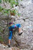 Young female rock climber
