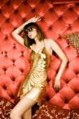 Sensual Young Woman In Golden Dress And Glasses