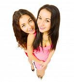 Two smiling funny girls isolated