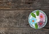beautiful cupcake on vintage wooden background