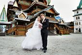 Bride And Groom About The Wooden Palace