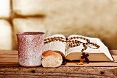 stock photo of prayer beads  - still life with bible and prayer beads - JPG