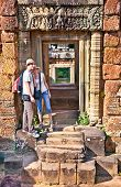 Beautiful young couple at door of Prasat Pre Roup temple in Angkor wat complex, near Siem Reap, Cambodia.