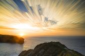 stock photo of unique landscape  - Unique time lapse stack sunrise landscape over rocky coastline - JPG