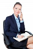 Smilling Business Woman Sitting On Chair And Using Mobile Phone