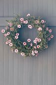 Spring wreath with flowers hanging on hook