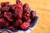 Diet Healthy Food. Dried Cranberries In Bowl On Wooden Table Background