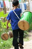 carrying a drum