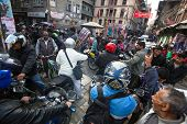 KATHMANDU, NEPAL - DEC 1, 2013: Traffic jam in one of a busy street in the city center. With an area