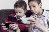 Two kids playing on mobile phone