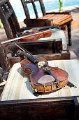 Violin And Fiddle Stick On Chair