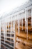 foto of chalet  - Long Icicles Melting of a Log Wood Chalet roof top - JPG