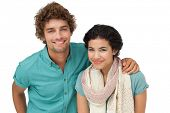Portrait of a smiling casual young couple over white background