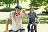 Happy couple enjoying bike ride in a park