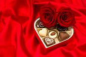 Red Roses And Assorted Chocolate Pralines In Gift Box