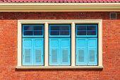 Blue Window On Brick Wall