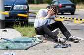 Sad Man At Accident Scene