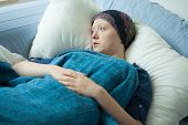 pic of leukemia  - Sad woman with cancer lying in bed