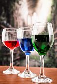 Glasses with blue red and green liquid cocktails