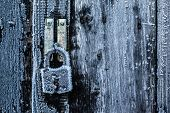 picture of doomsday  - A padlock with ice crystals growing on it in the cold winter - JPG
