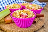 Cupcakes With Rhubarb In Tins On Board