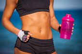 Close-up of torso of athletic fitness woman