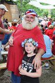 MUSKOGEE, OK - MAY 24: A senior veteran and his granddaughter enjoy the Oklahoma 19th annual Renaiss