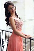 Beautiful Woman In Luxurious Dress Posing On Balcony