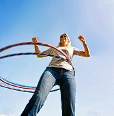 a woman hula hooping on a clear day