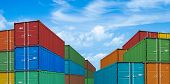 export or import shipping cargo containers stacks in port under sky