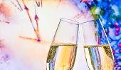 New Year Or Christmas At Midnight With Champagne Flutes Make Cheers On Clock Background