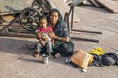 Mother With Childs Rests On Courtyard Of Jama Masjid Mosque In Delhi