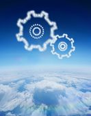 Cloud in shape of cogs and wheels against blue sky over clouds at high altitude