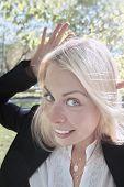 image of tease  - young beautiful woman teasing outdoor vertical shot  - JPG
