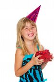 Girl with a birthday gift and cap