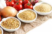 foto of millet  - Millet spelt bulgur and vegetables on wooden table - JPG