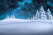 White snowy landscape with fir trees against aurora night sky in blue