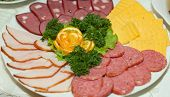 Meat And Cheese Slices On Plate