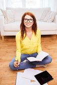 home, education, technology and people concept - smiling teenage girl sitting on the floor with tabl