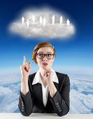 Thinking redhead businesswoman against blue sky over clouds at high altitude