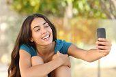 Happy Teen Girl Taking A Selfie Portrait With Her Smart Phone