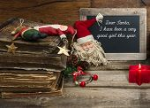 Vintage Christmas Decoration With Antique Toys And Red Candle